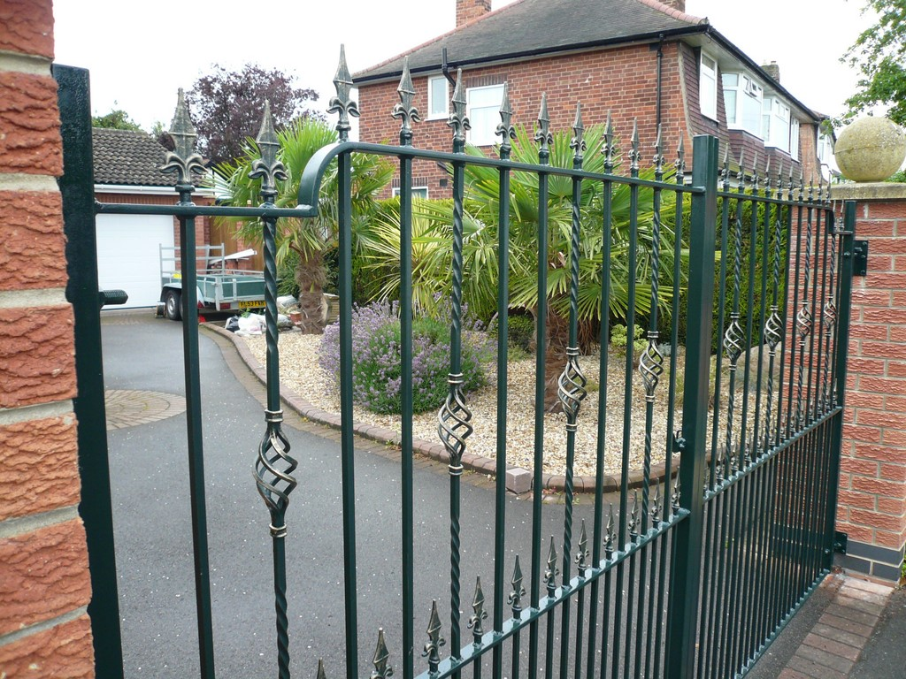 Double Gates with Ironwork Baskets